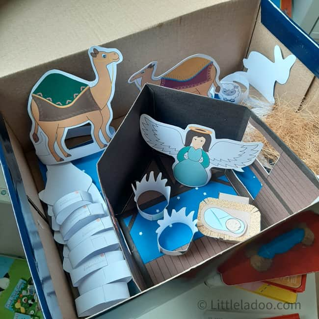 Paper nativity set packed in a cardboard box