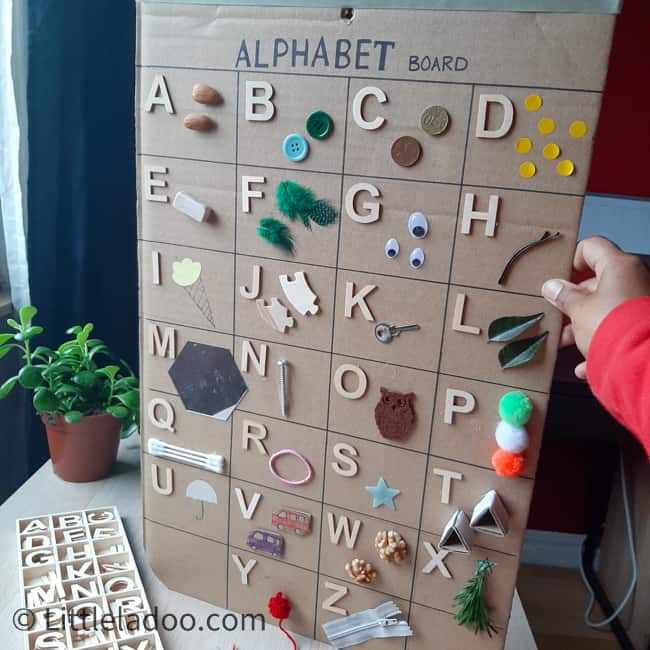 alphabet board with everyday objects